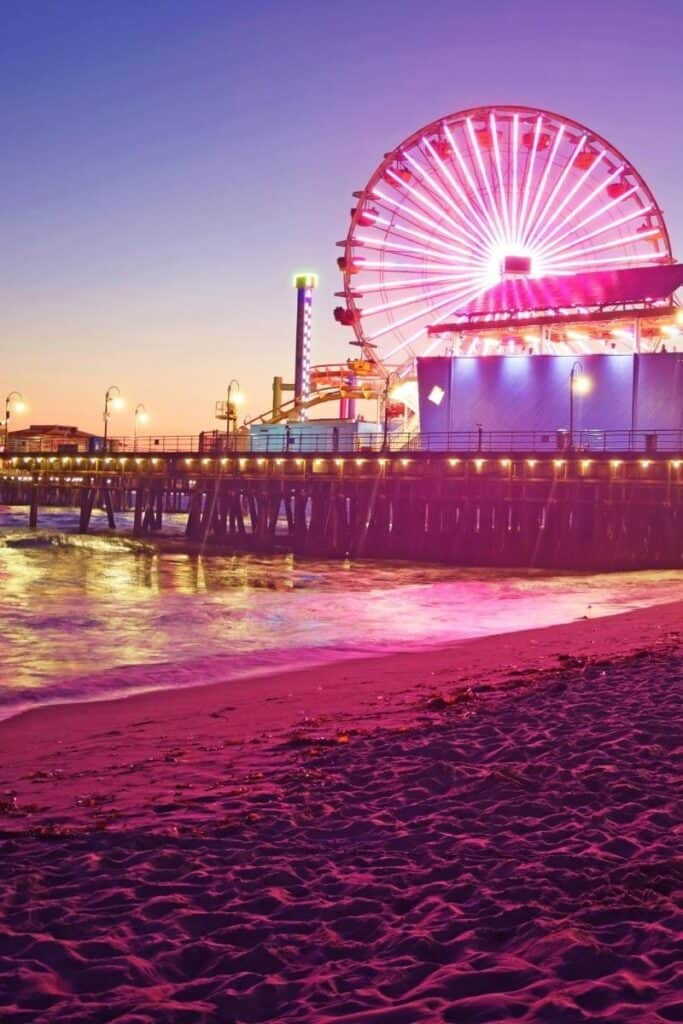Neon pink colored photo of Santa Monica pier with beach and giant Ferris wheel