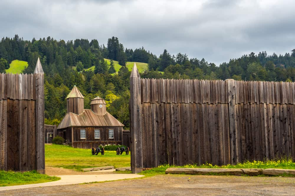 Wooden fence and wooden fortified building at Fort Ross near Jenner