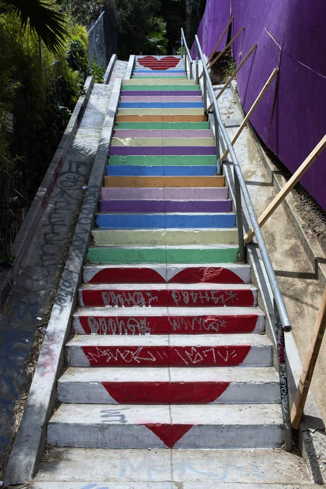 Famous rainbow step staircase in Los Angeles with hearts at top and bottom of stairs.