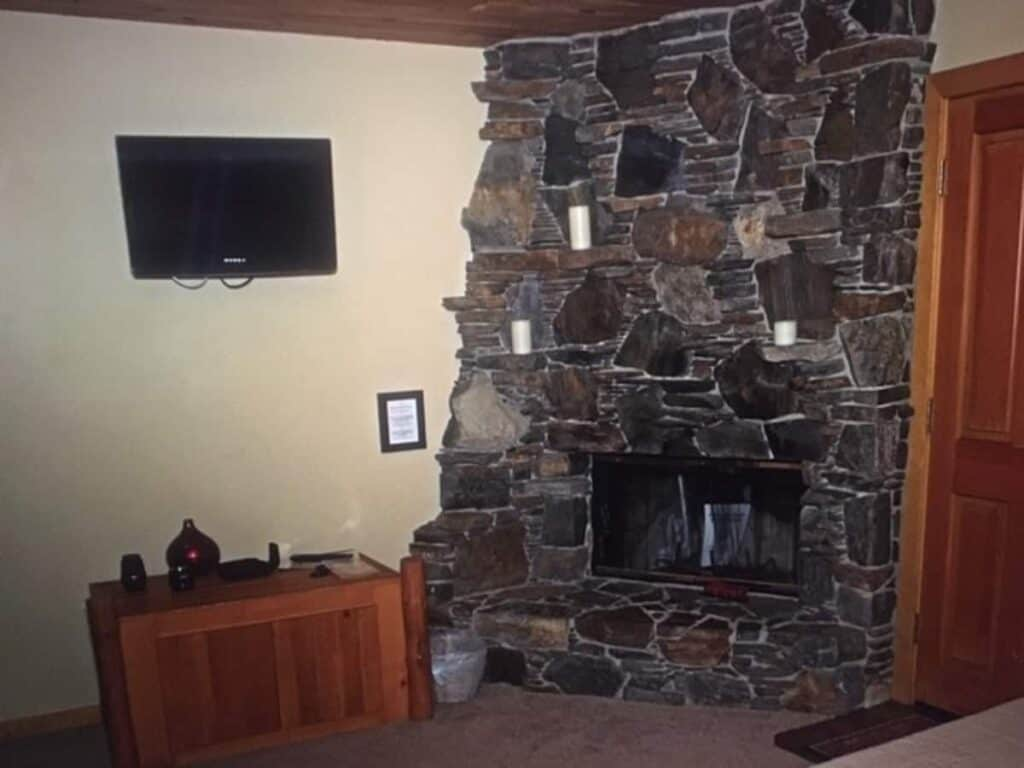 Fireplace view with flatscreen TV