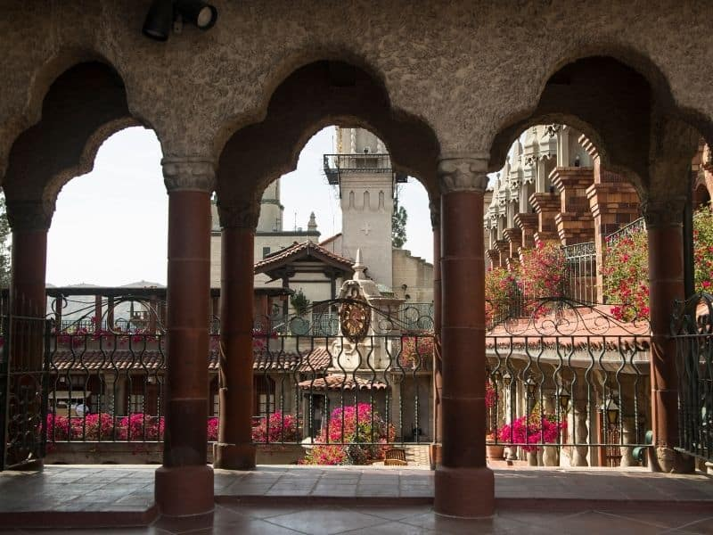 A view through the arches at the famous Mission Inn in Riverside, California, one of the most famous places to celebrate Christmas in California.