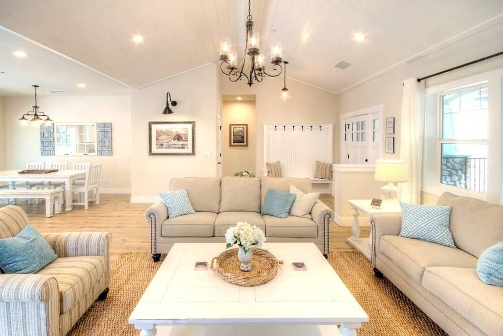 Bright white interior with tan sofas with light blue pops of color