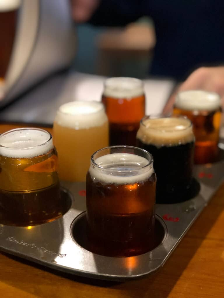 Sampling flight of six different beers at Mammoth Brewing Company: a Mammoth Lakes winter must-visit!