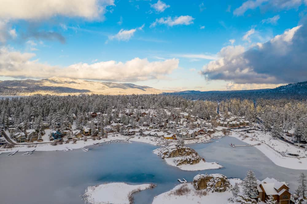 Aerial view over Big Bear in winter taken from helicopter or drone