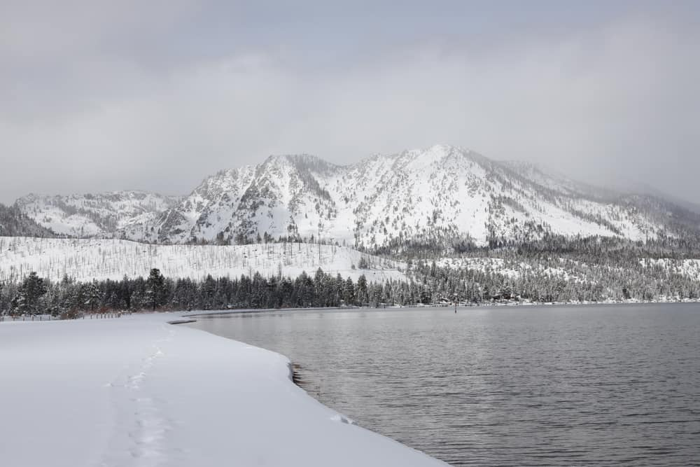 A cloudy day in Lake Tahoe in winter enjoying cross-country skiing next to the lake