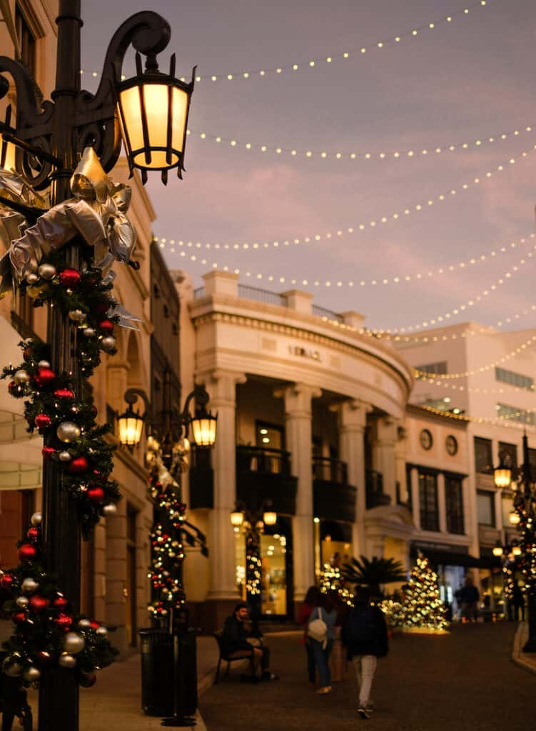 A photo of Rodeo Drive in Los Angeles at Christmas with holiday lights and decorations and trees