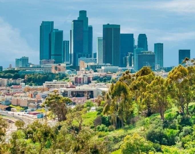 los angeles skyline from afar with greenery and skyscrapers