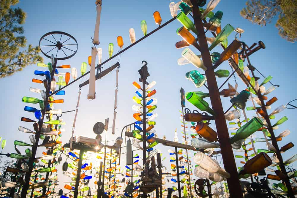Art installation with collected beer bottles and other glass bottles at Elmer's Bottle Tree Ranch, San Bernardino, California, between Los Angeles and Vegas.