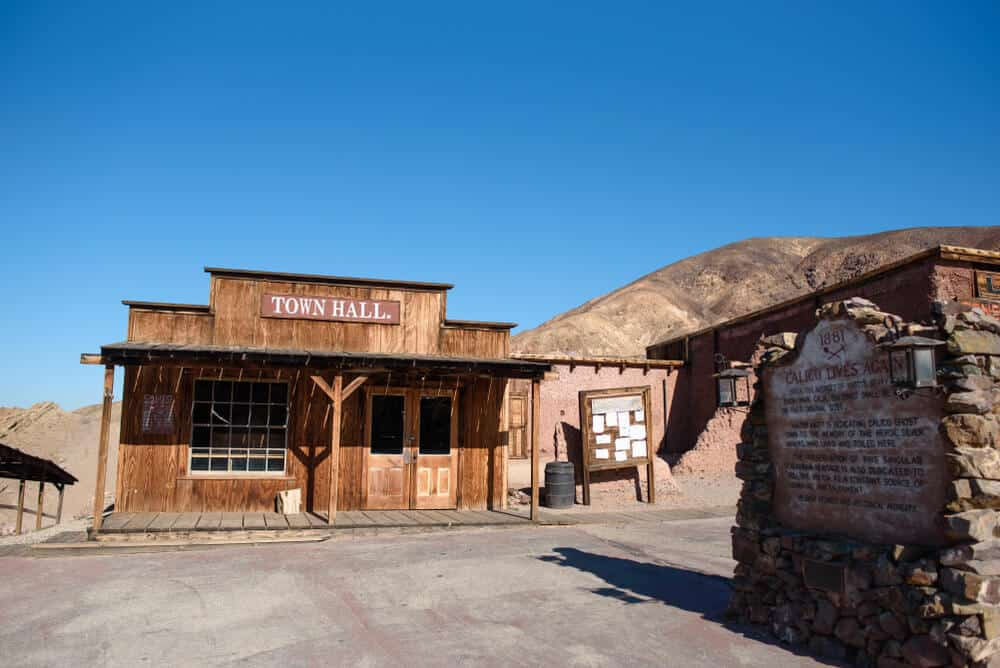 """A wooden old-timey building that says """"Town Hall"""" in the abandoned mining town of Calico, California, a road trip stop between Los Angeles and Las Vegas"""