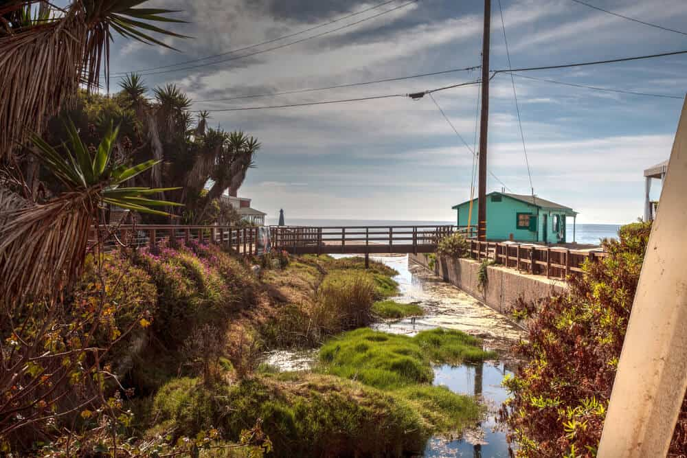Bridge and Beach cottages line Crystal Cove State Park beach and are right on the sand with an ocean view in Newport Beach, California