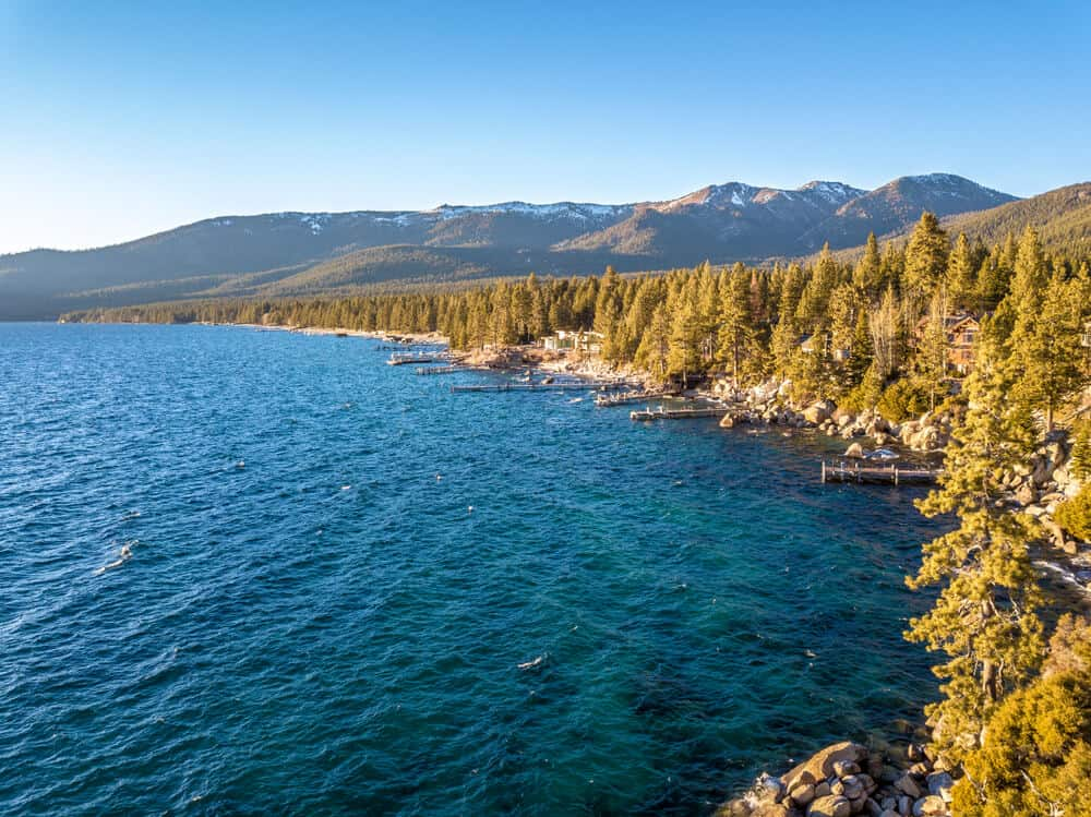 Emerald blue waters surrounded by pine trees and mountains on the west shore of Lake Tahoe, camping heaven!