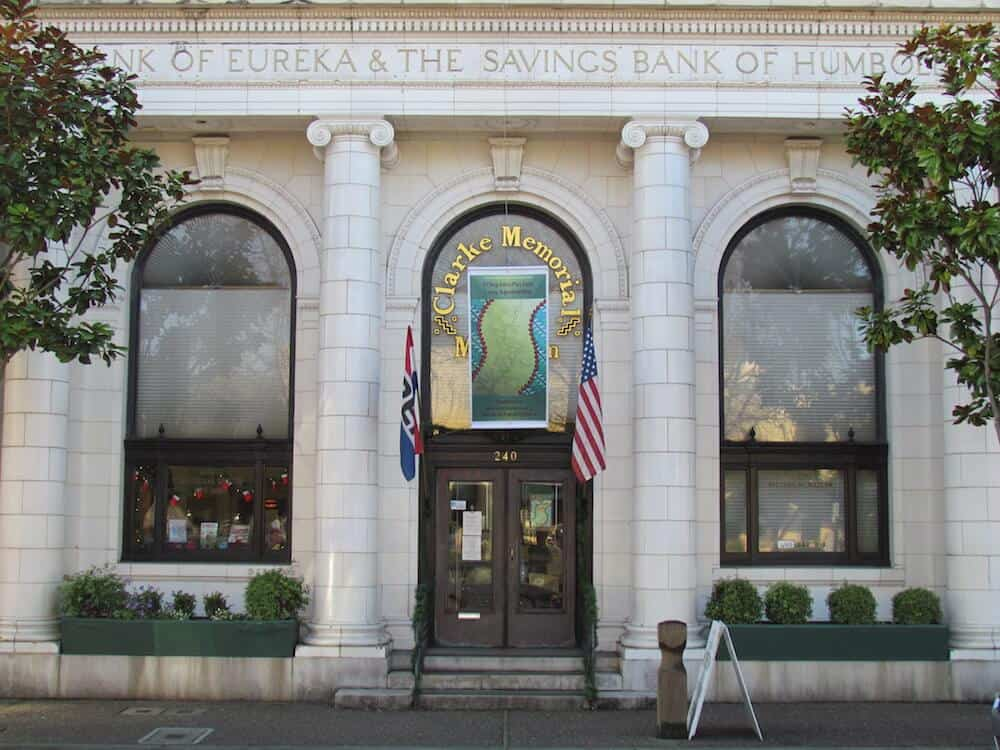 Clarke Memorial Museum housed in the old Bank of Eureka & Savings Bank of Humboldt County. Two flags in front.