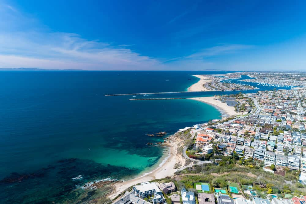 Aerial view over the city of Newport Beach in orange county as what you would see from a helicopter tour over the city.