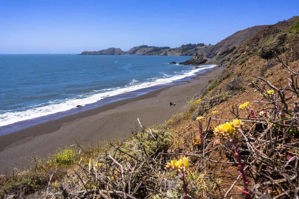 A black sand beach in the Marin Headlands near San Francisco: date idea for those who love the water!