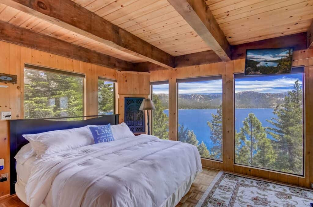 A small studio Airbnb in Tahoe with nearly floor to ceiling windows looking onto the brilliant blue waters of Lake Tahoe.