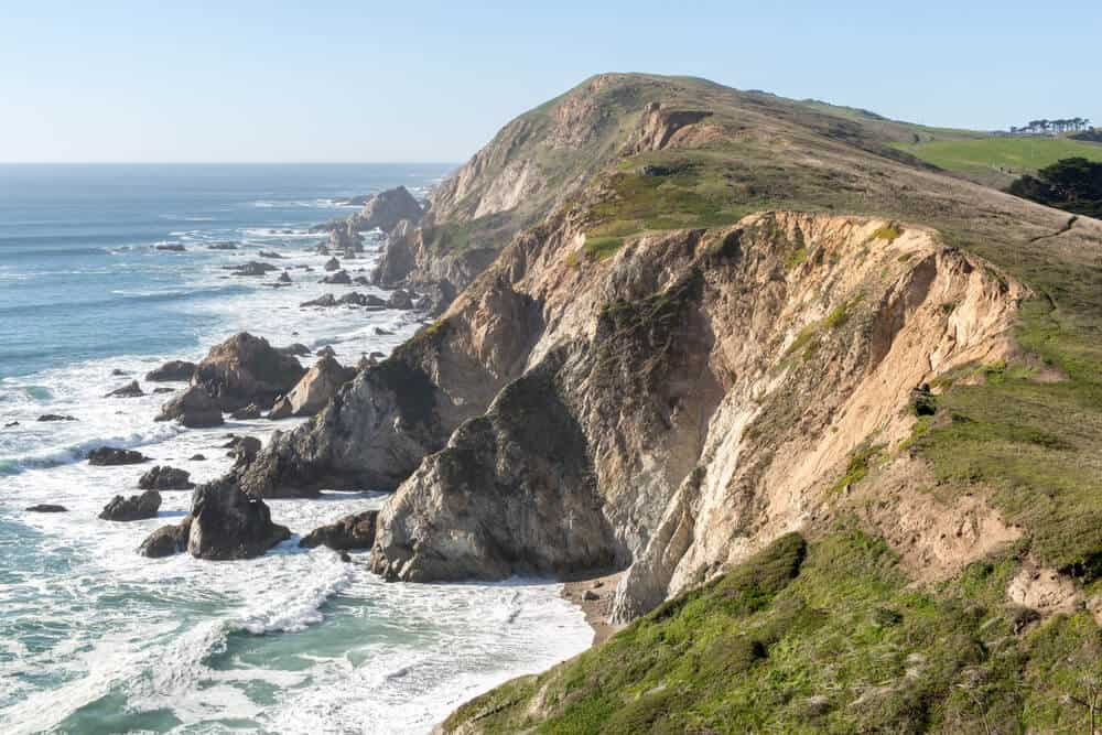 The beautiful and wild rugged coastline along Chimney Rock Trail, a famous hike in Point Reyes National Seashore, where small rocks and cliffs crash into the sea.