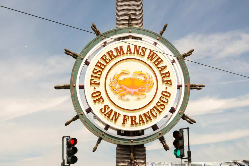 Sign that reads Fishermans Wharf of San Francisco in the shape of a wheel of a ship