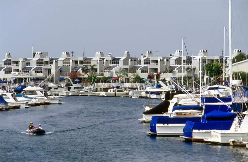 Fancy boats and fancy white houses of Huntington Harbor