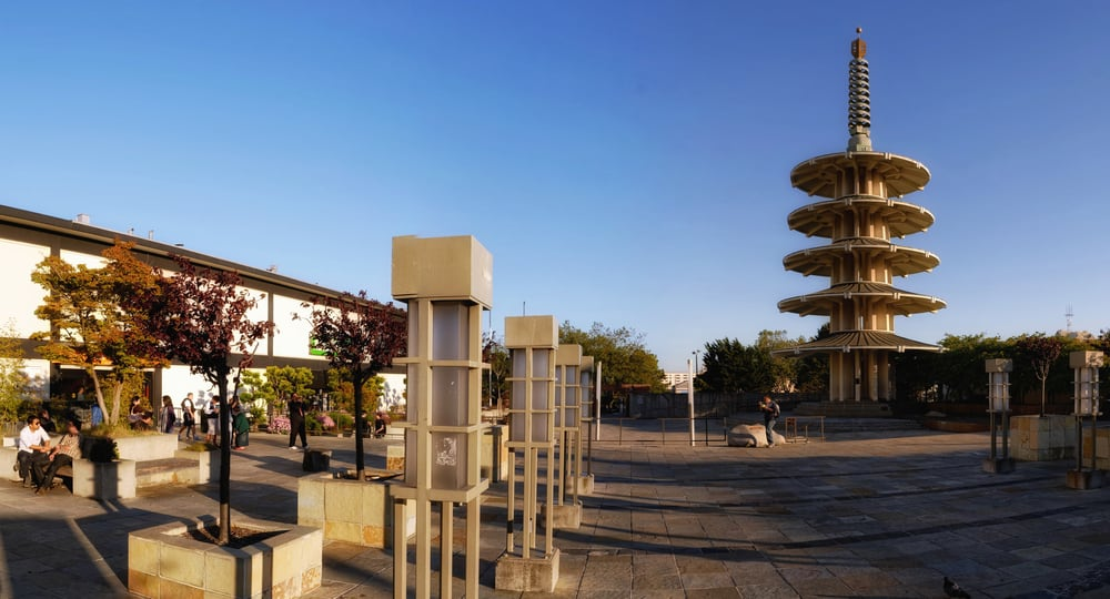 Four-tiered circular Peace Pagoda in a public park in San Francisco, filled with other architectural and sculptural pieces.