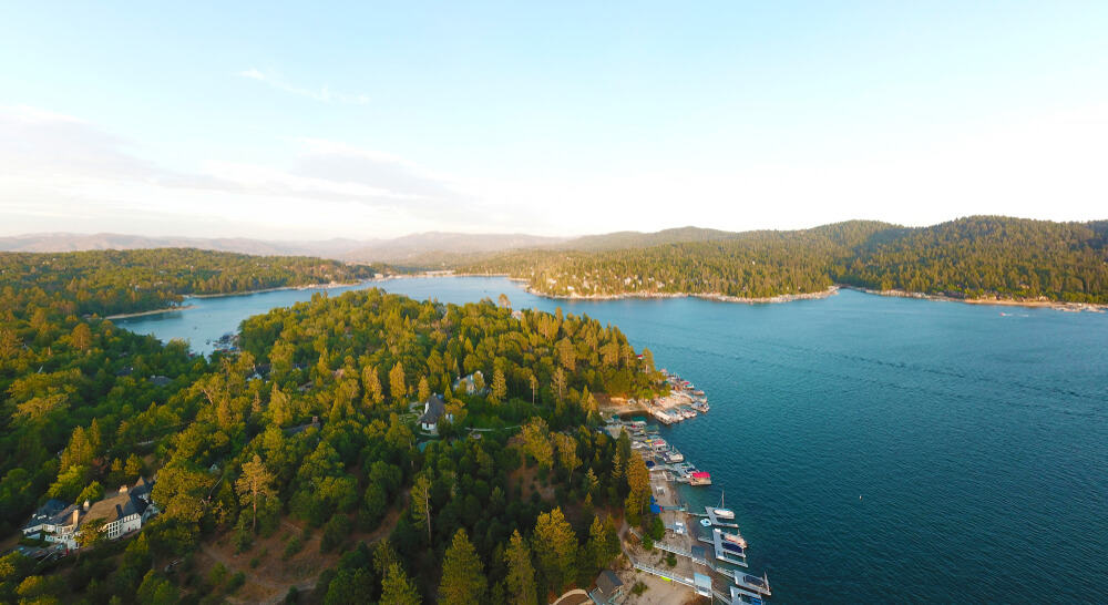 the charming lake arrowhead in california with trees and water