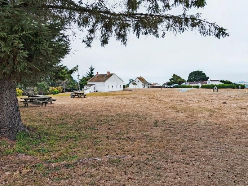 White houses and picnic tables make up part of the Fort Humboldt State Park near Eureka