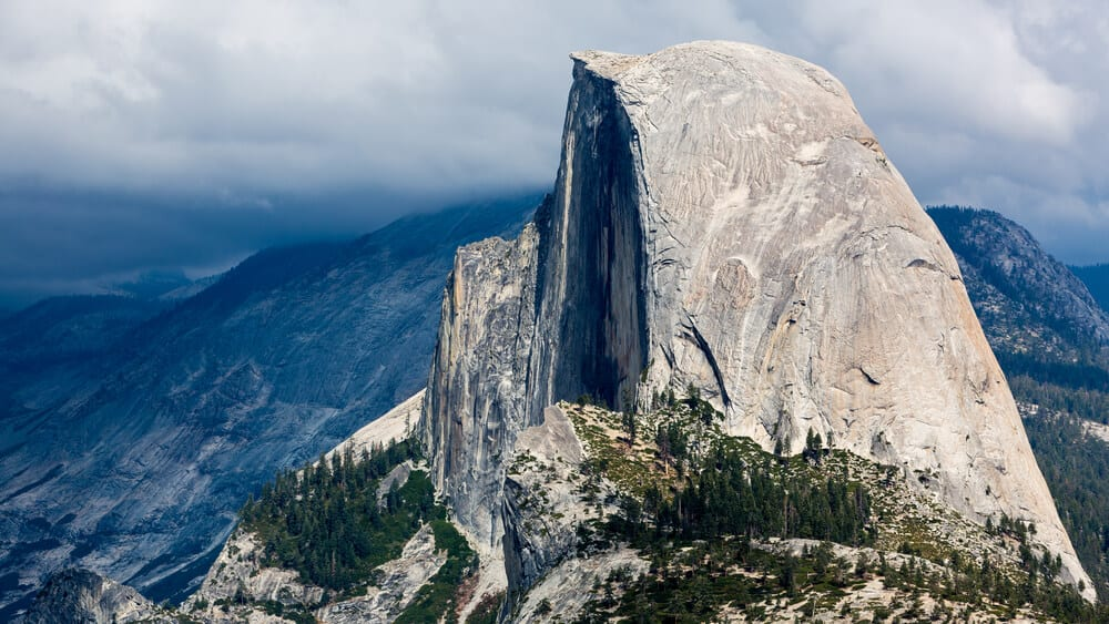 Close up photo of the famous Yosemite Half Dome, as seen from the hike, which requires a permit and a treacherous hike.