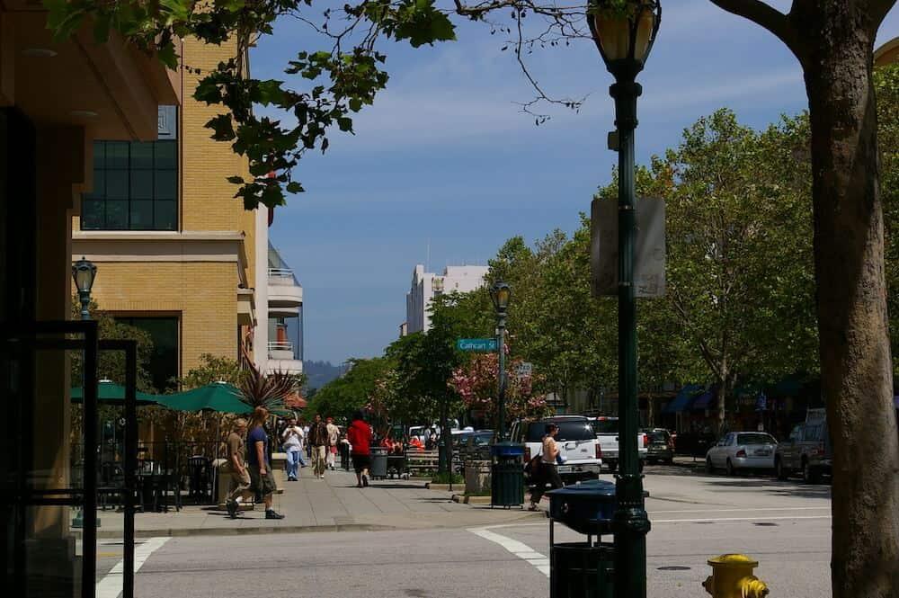 People walking on Pacific Avenue in downtown Santa Cruz