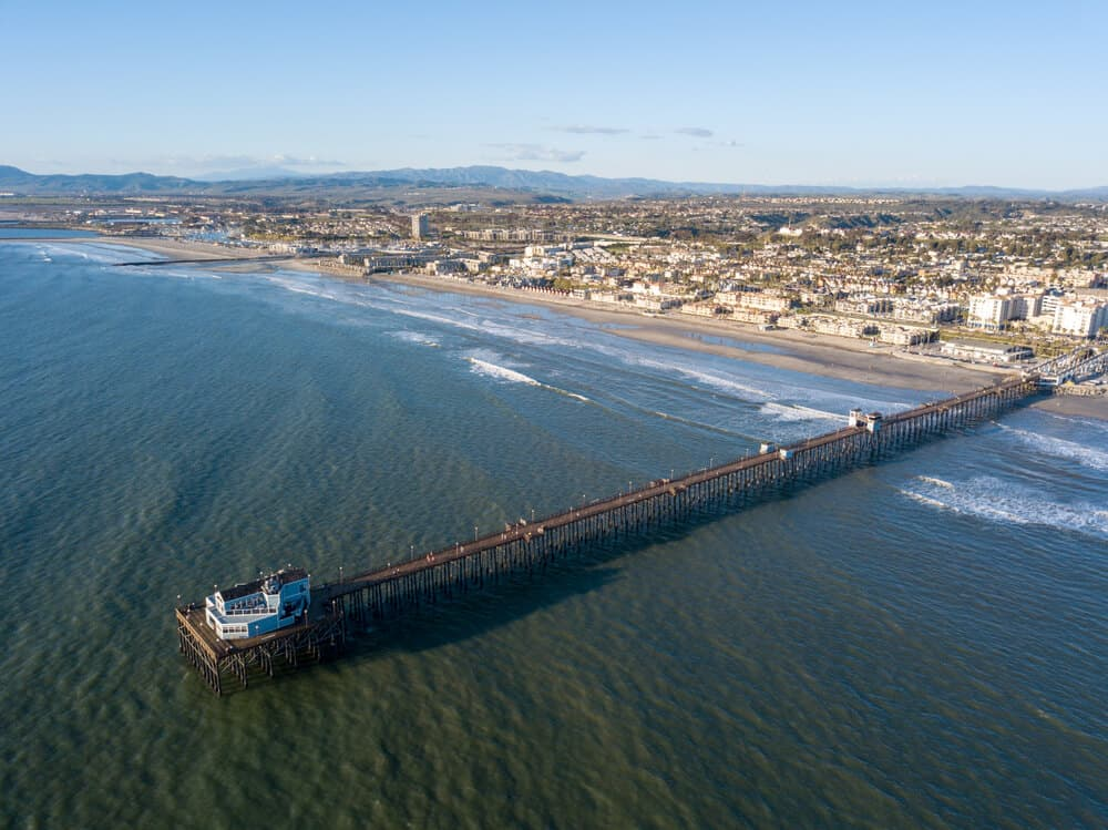 Oceanside Pier from an aerial view as if taken from a helicopter over the ocean
