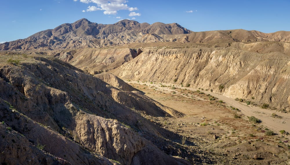 Rocky cliffs and mountains overlooking a valley on a hike in Anza Borrego along the mine outlook