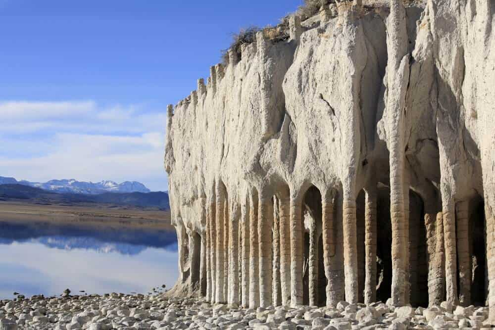 Strange stone columns that look as if they are manmade next to a lake, at Lake Crowley