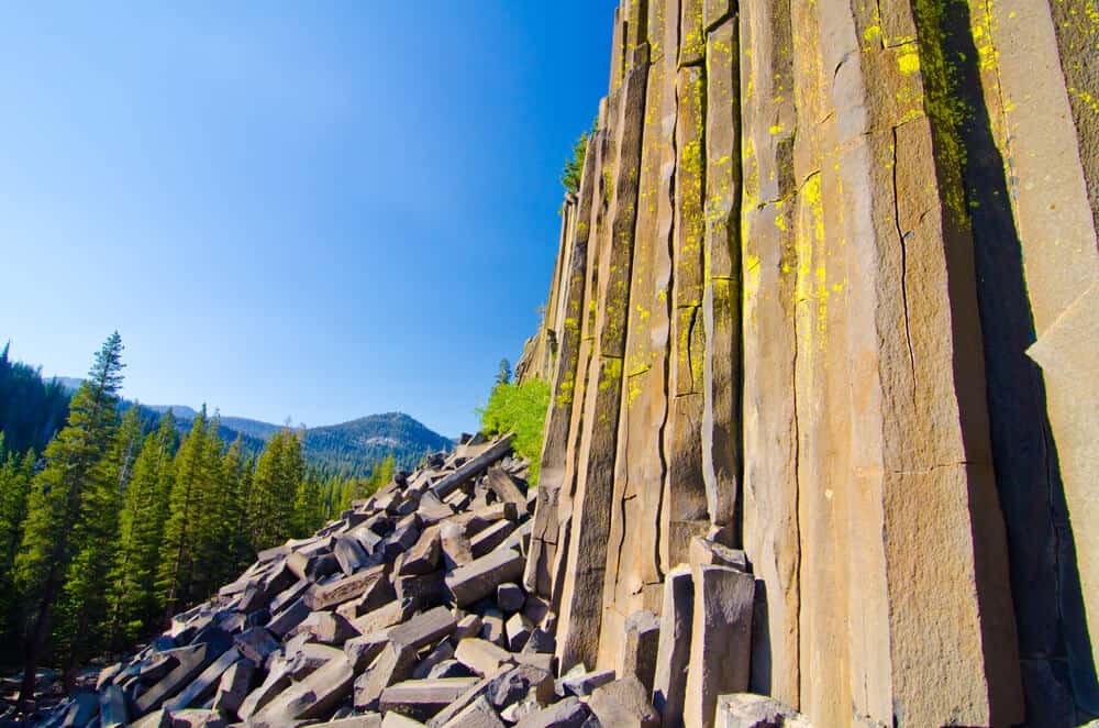 Basalt columns both standing and fallen over, like bricks made of stone, on a clear day hiking the John Muir Trail