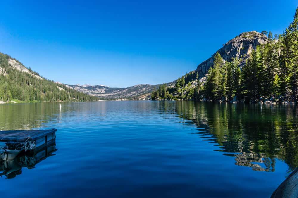 Dark blue waters of Echo Lake gently reflecting the scenery back