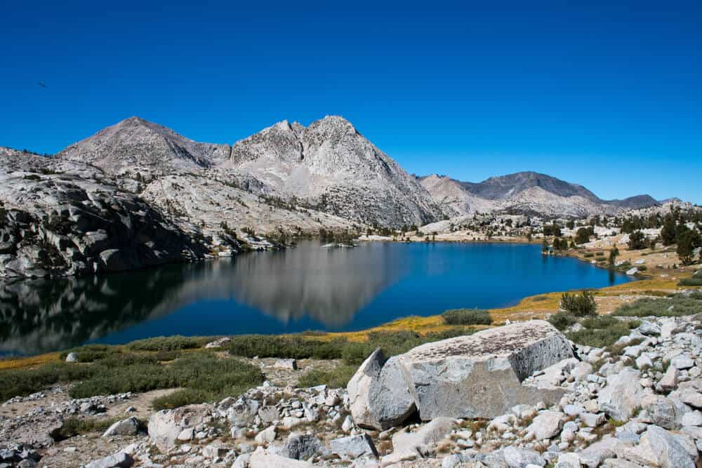 Clear blue waters of Evolution Lake along the John Muir Trail hike