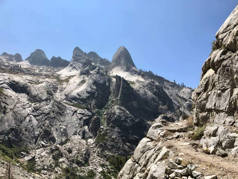 The High Sierra Trail in the Sierra Nevada Mountains and Sequoia National Park. Rocky mountainous landscape with a hiking trail edging along the mountain.