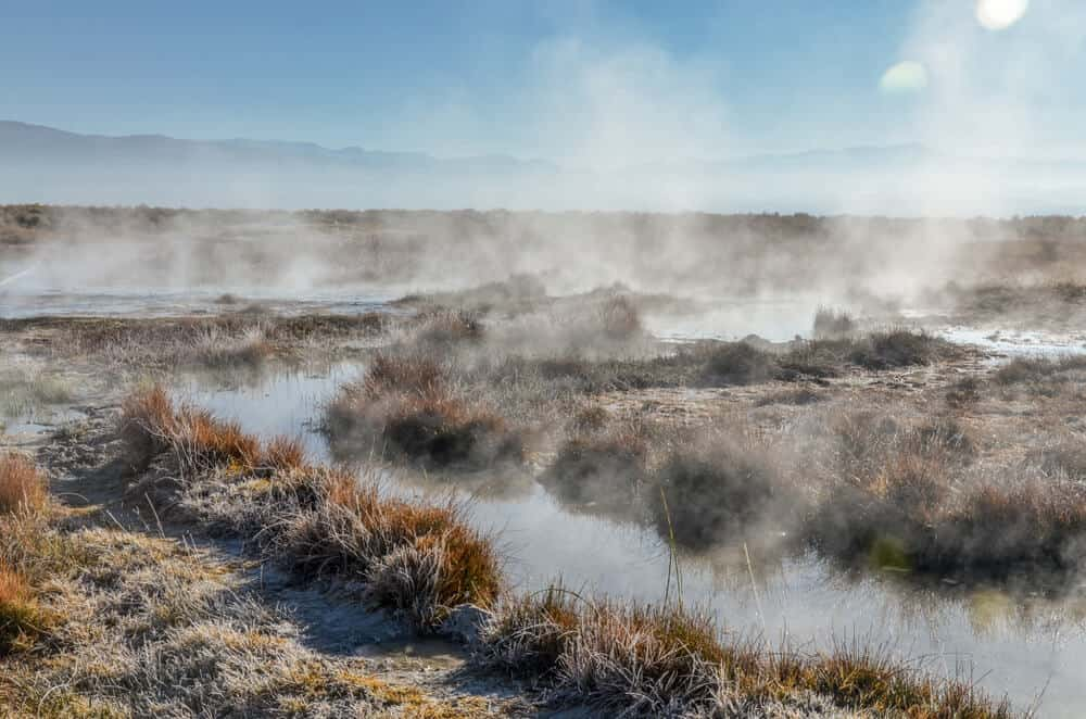 Steam rising off the creek waters in a geothermal hot spring near Mammoth, a popular place for stopping when road tripping Highway 395