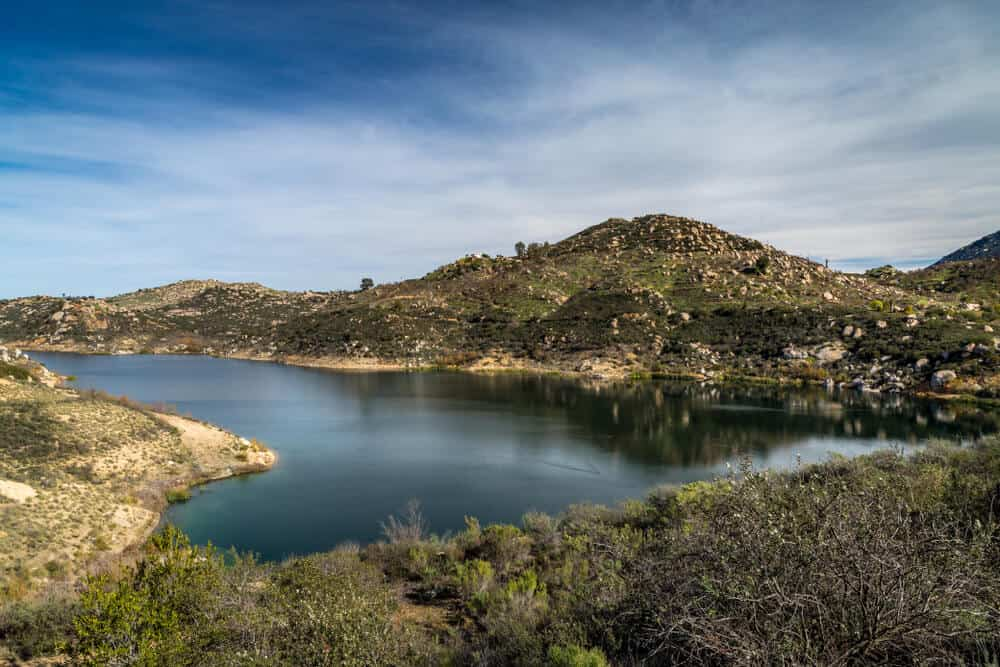Beautiful Lake Ramona surrounded by mountains in an elevated location seen from the Green Valley Truck Trail, Blue Sky Ecological Reserve