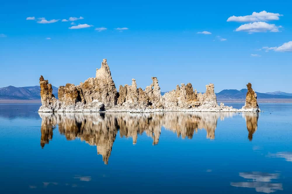 Tufa formations in Mono Lake looking like a castle in the water on a sunny day