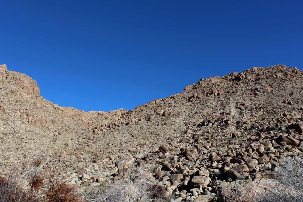Below the deep blue Southern Mojave Desert sky rises ridges bounding Rattlesnake Canyon of Joshua Tree National Park.