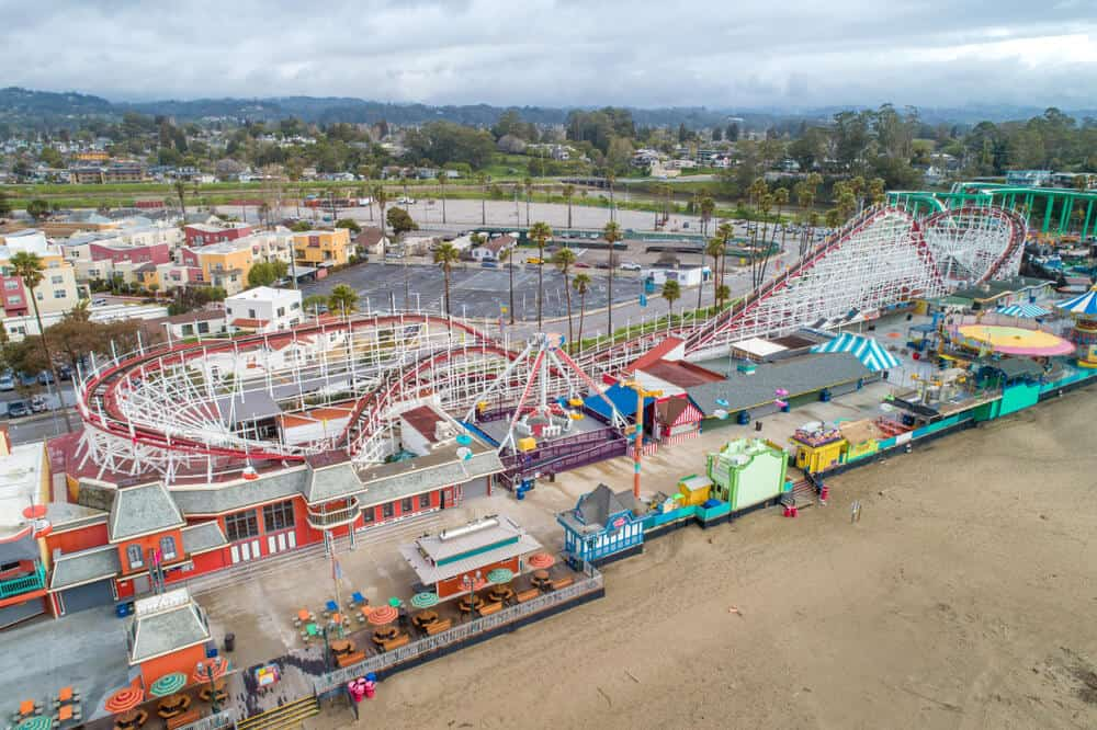 the boardwalk at santa cruz california on the beach with rides and roller coasters