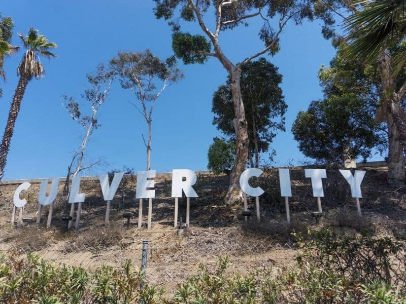 sign for culver city surrounded by brush and trees