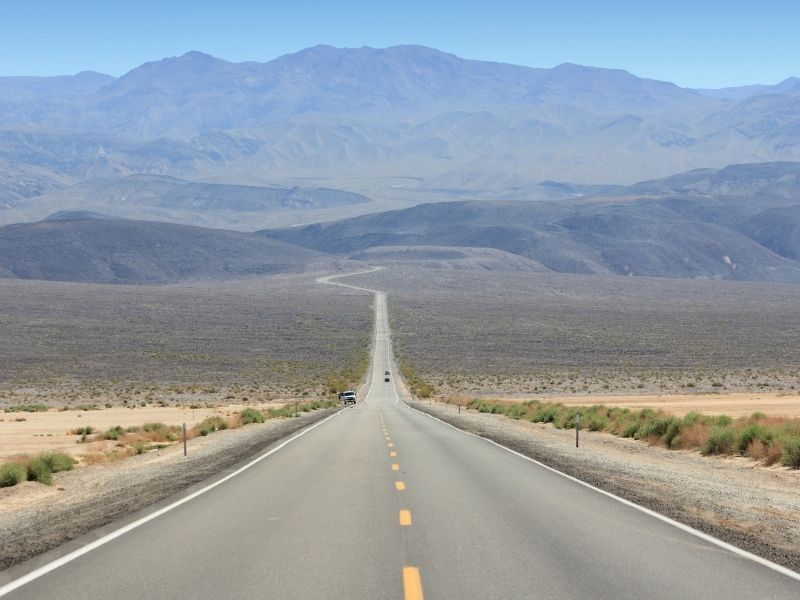 a nearly empty road in death valley national park