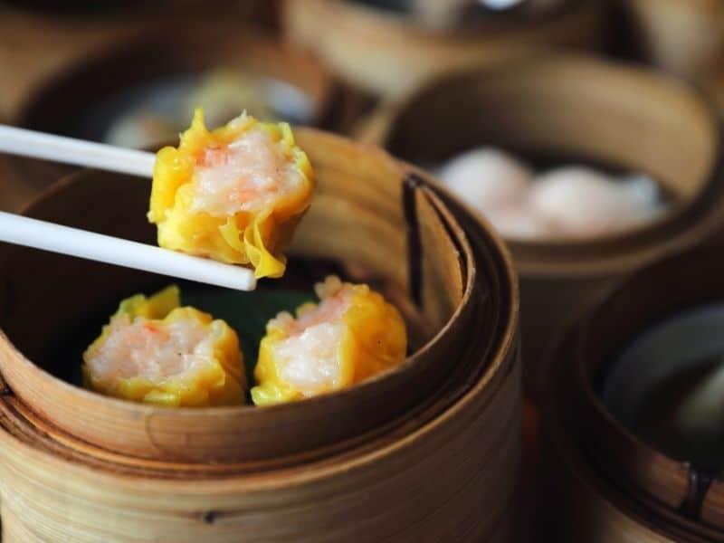 eating dim sum with chopsticks