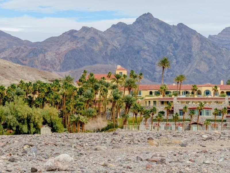 the inn at furnace creek surrounded by palms, oasis and mountains