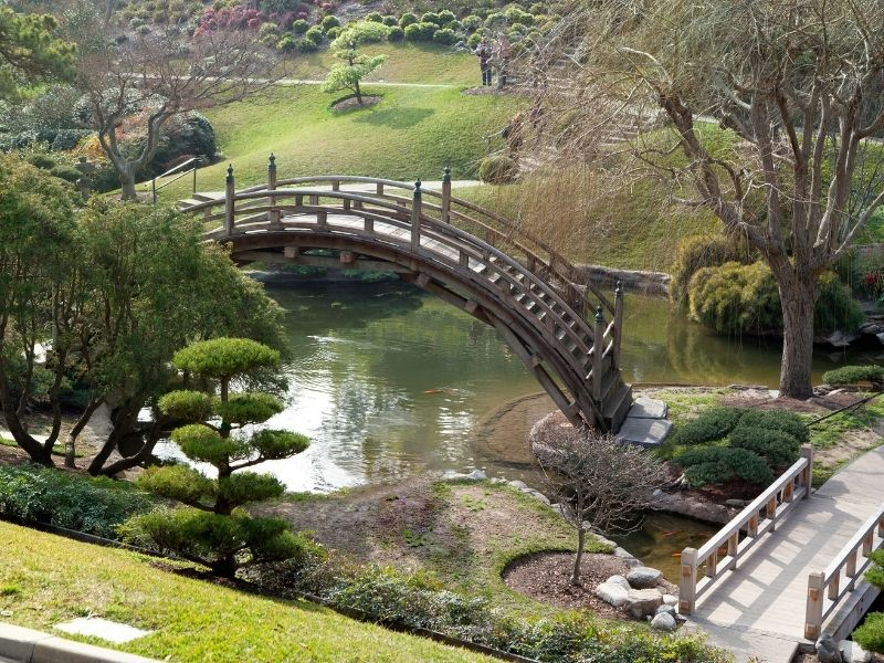 japanese style garden in los angeles with an arched bridge, one of the romantic things to do in los angeles