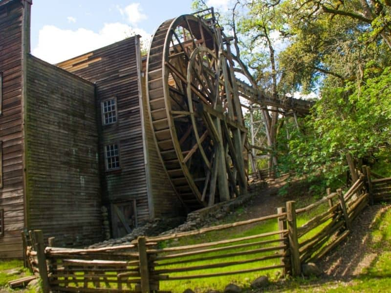 water-powered wheel that mills grist in a park near calistoga
