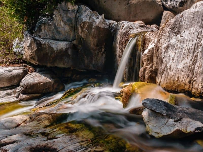 waterfall emptying into a basin in sequoia national park along a popular hike