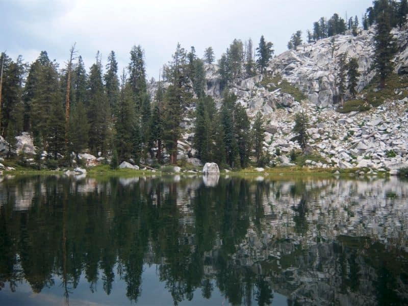 the mirror like waters of the beautiful heather lake a popular hike in sequoia