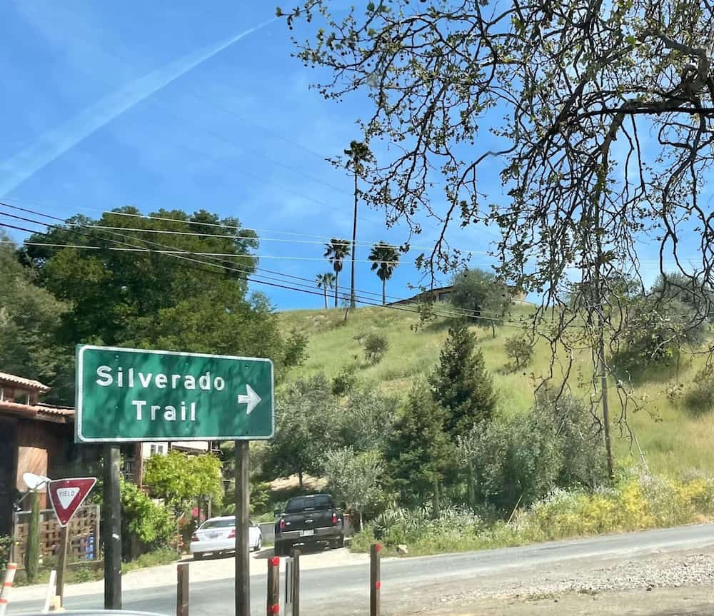 green and white sign that reads 'silverado trail' on a road in Calistoga California