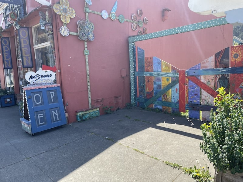 a painted fence that leads to art studios
