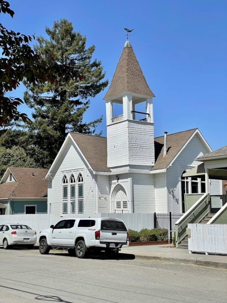 a white victorian-style church